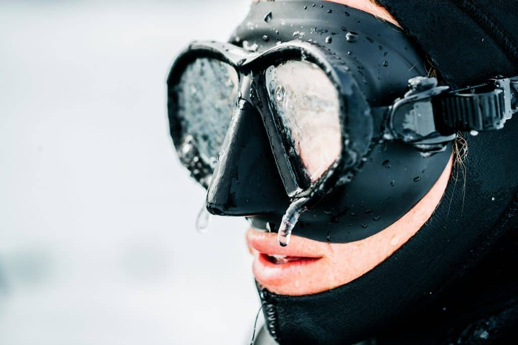 Cold Water Diving - Everything You Wanted To Know - Man wearing mask with ice